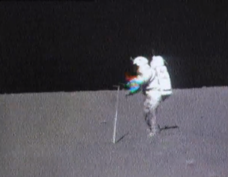 Astronaut tries to pick up hammer